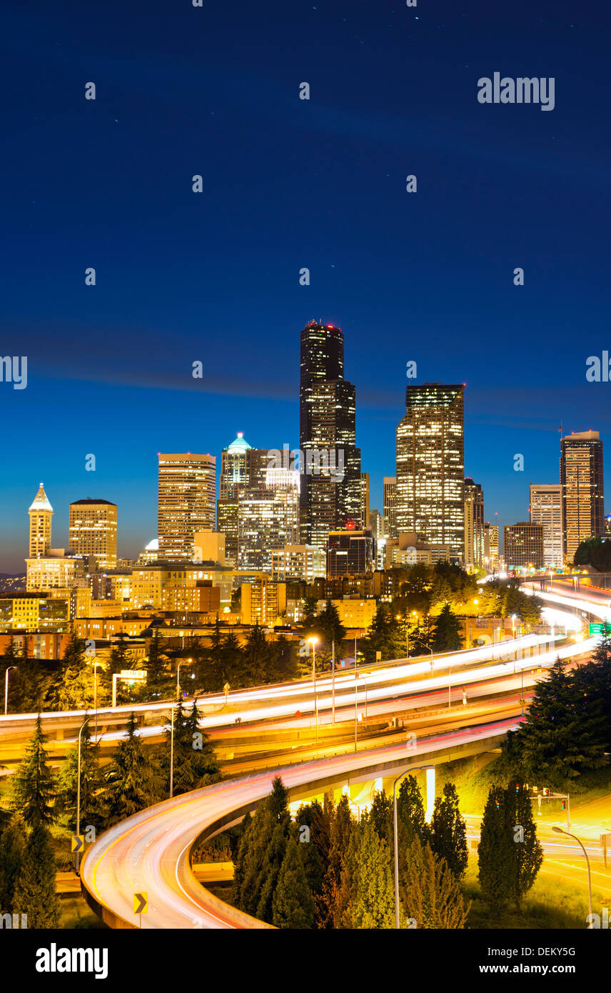 Freeways and Seattle skyline at night, Seattle, Washington, United States - Stock Image