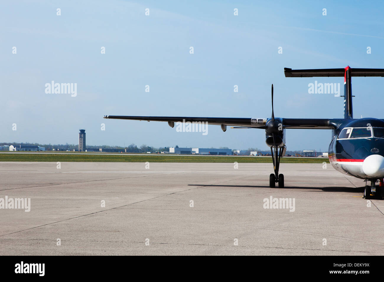Airplane taxiing on runway - Stock Image