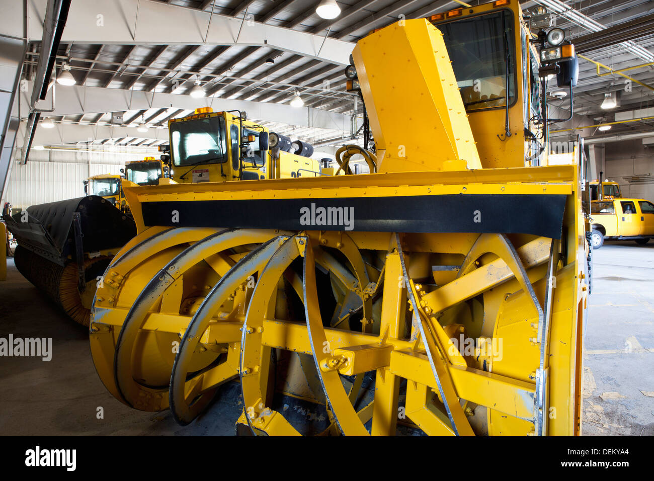 Close up of snowplow parked in warehouse - Stock Image