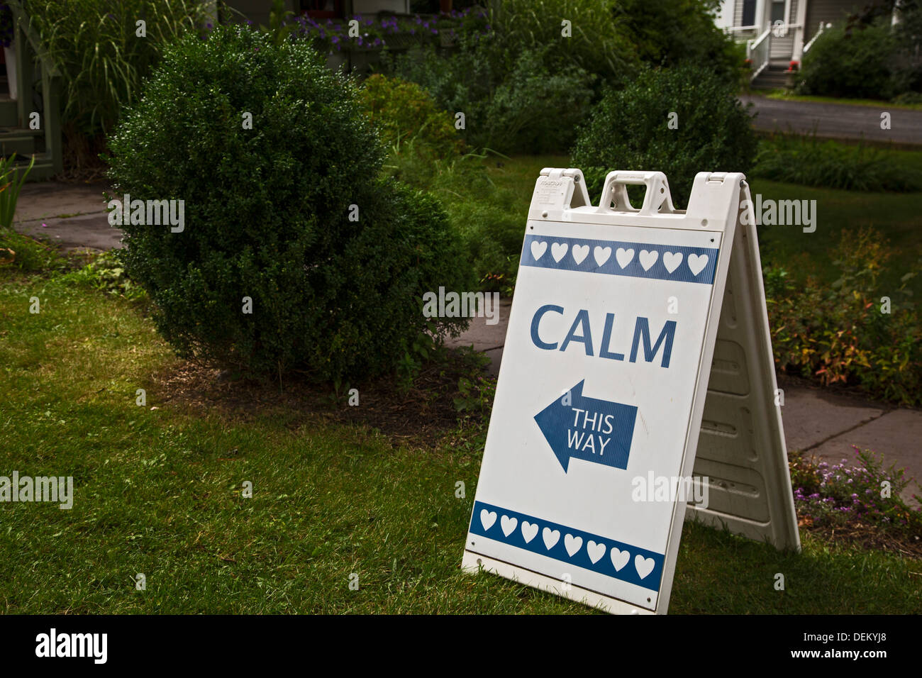 Woodstock, New York - A sign on Woodstock's main street points towards calm. - Stock Image