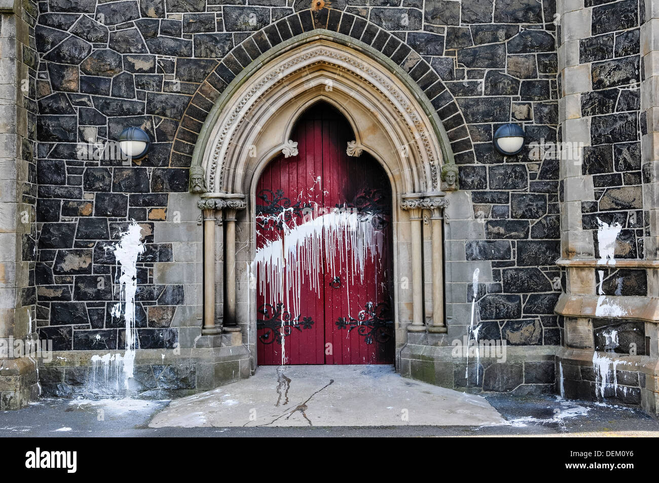 The door of a Roman Catholic Church suffers scorch damage from petrol bombs and paint during a sectarian attack © Stephen Barnes/Alamy Live News - Stock Image