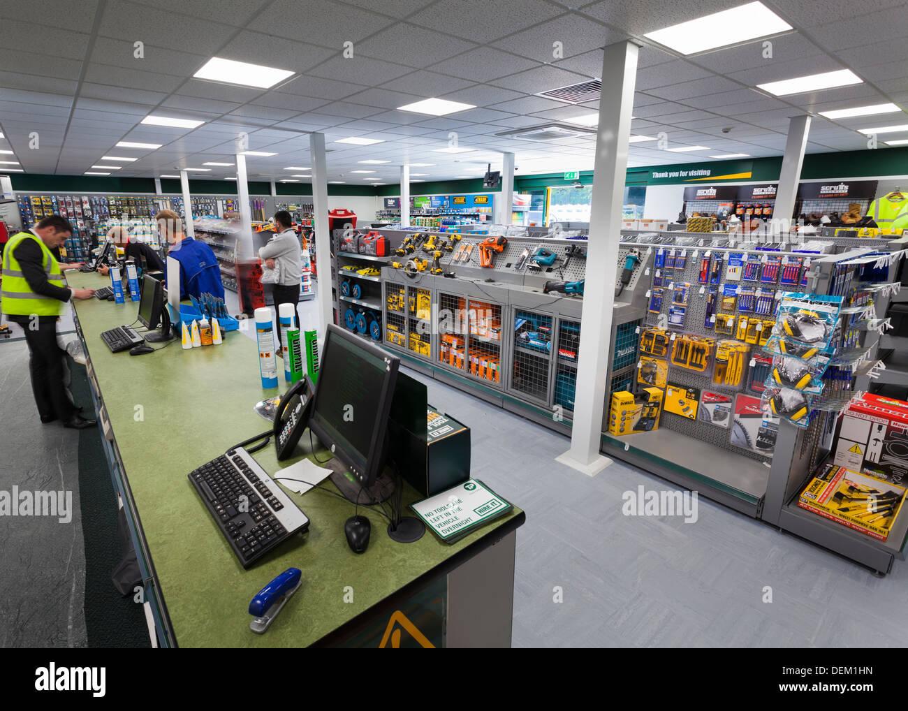 customers at sales counter in Travis Perkins Builders Merchants shop - Stock Image