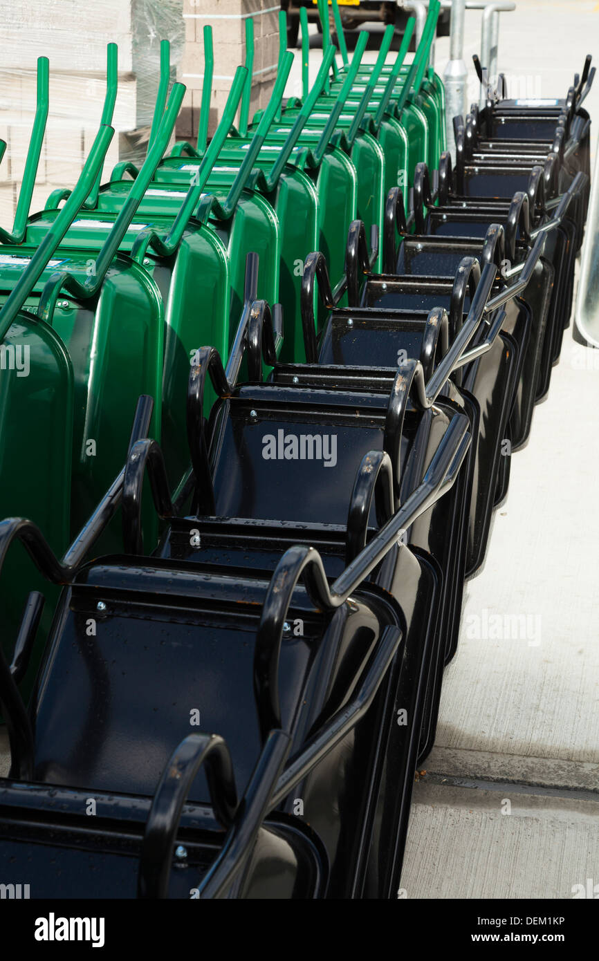 stacked rows of new builders wheelbarrows - Stock Image