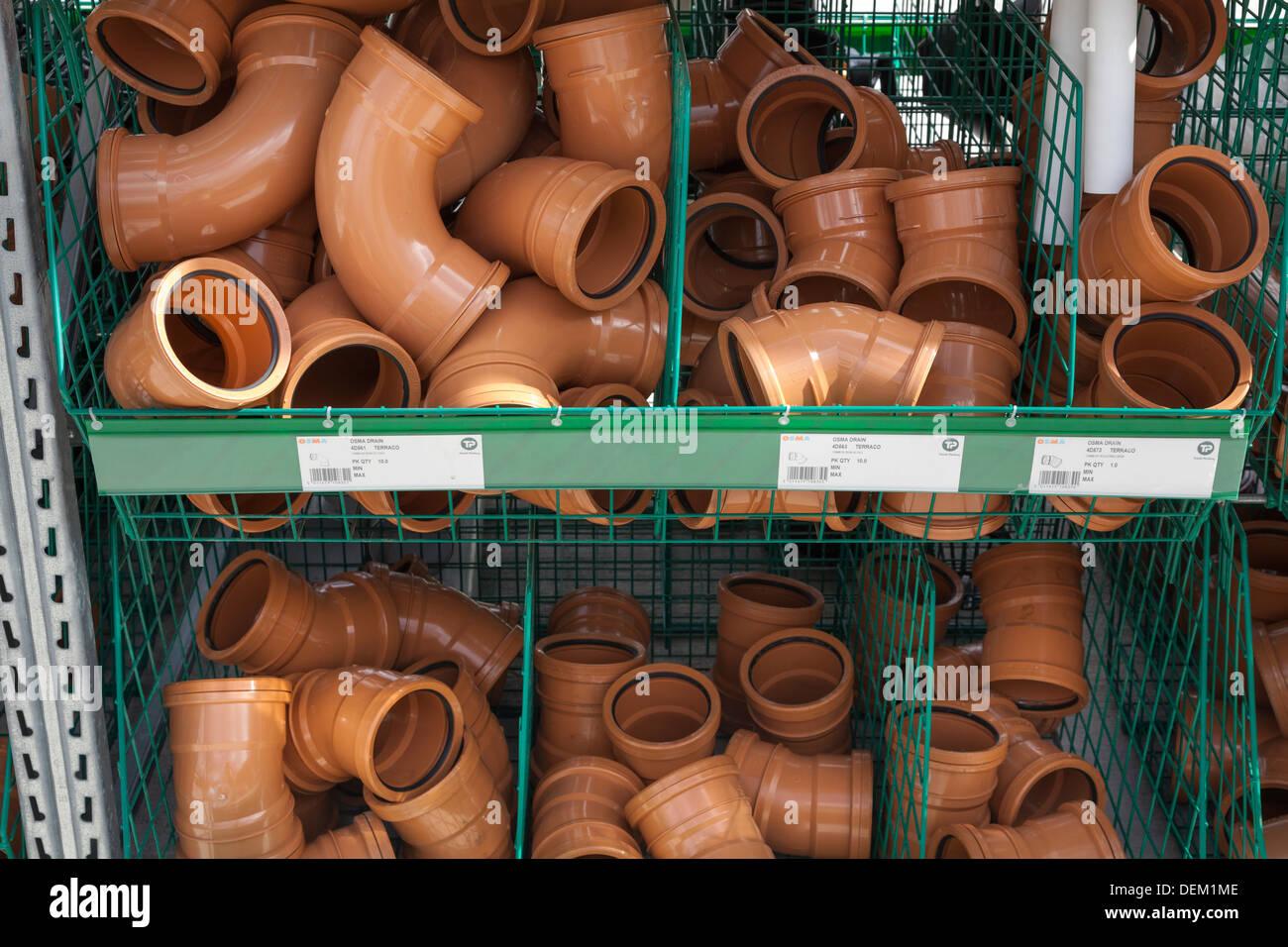 underground drain pipe fittings in builders merchants - Stock Image