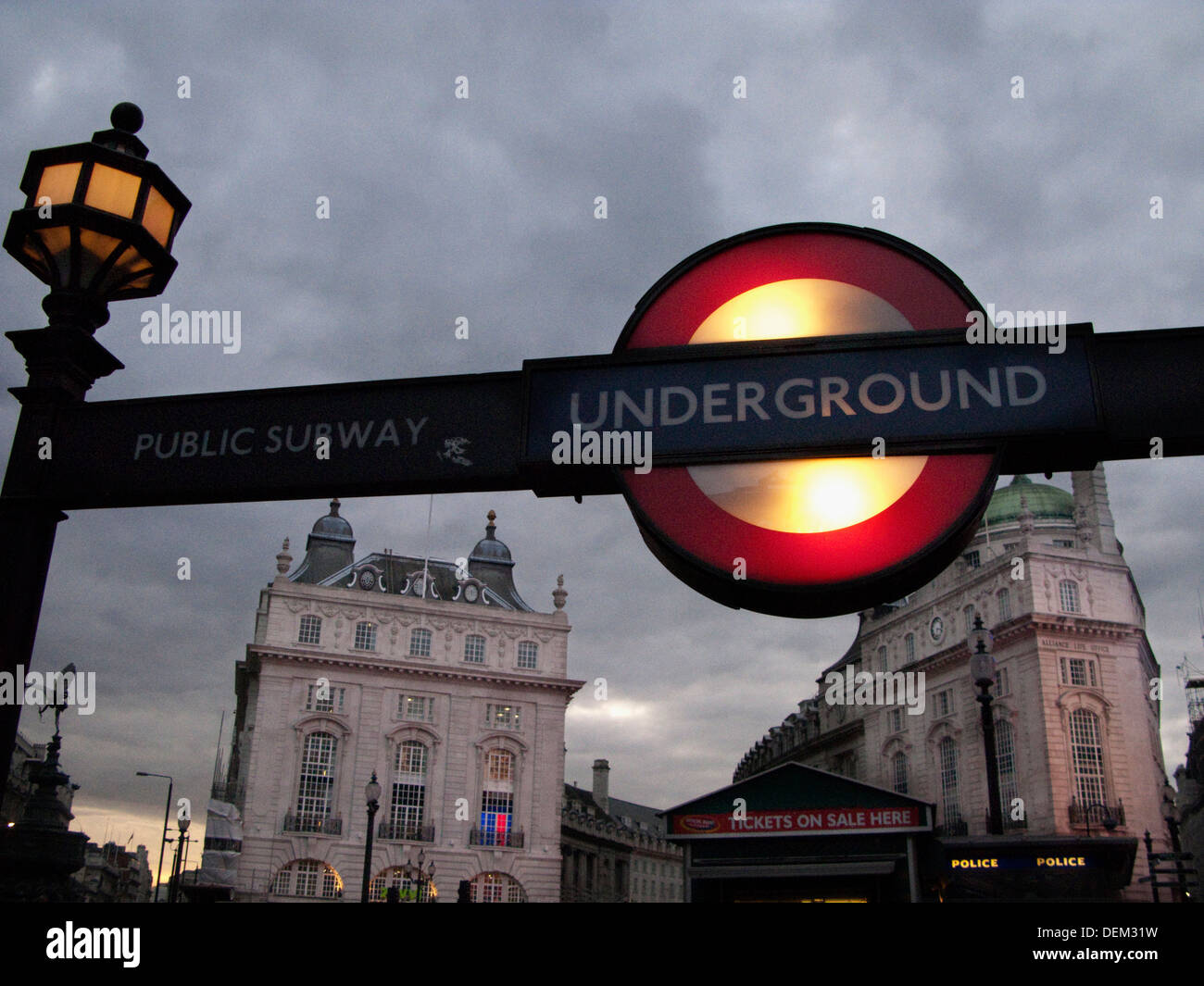 Underground Subway Sign with Buildings in Background, London, England - Stock Image
