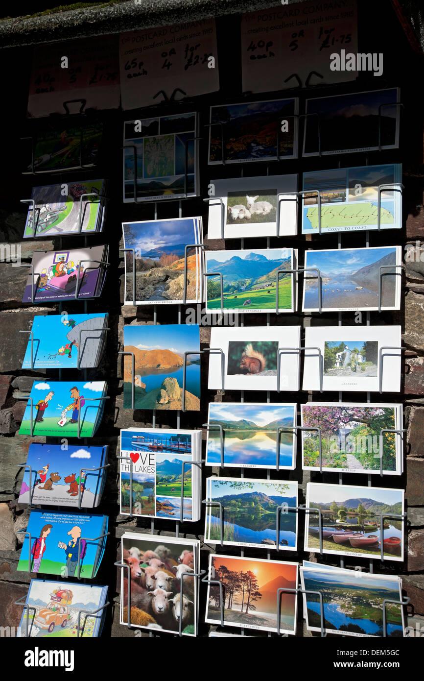 Racks of postcards for sale Cumbria England UK United Kingdom GB Great Britain - Stock Image