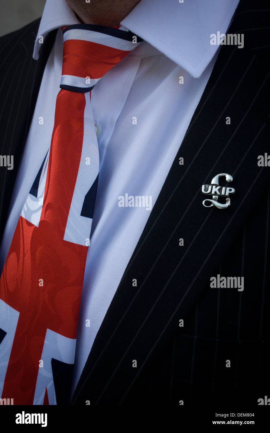 A Union jack tie and political pin detail of UKIP (UK Independence Party) member from Aylesbury Vale District council, Cllr Chris Adams. - Stock Image