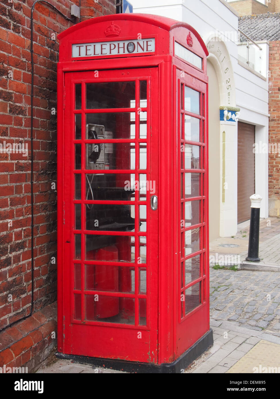 An old British red telephone box design K6 in Portsmouth, England - Stock Image