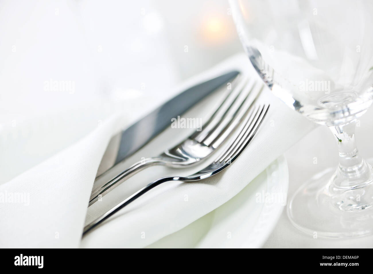 Elegant restaurant table setting for fine dining with plates cutlery ...
