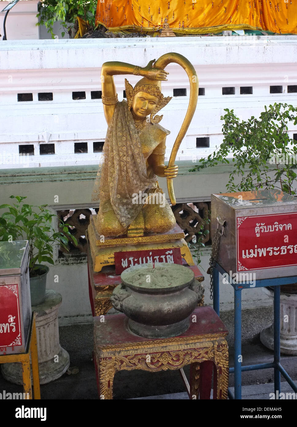 Phra Mae Thorani (Earth Goddess) statue at Buddhist temple in Bangkok - Stock Image
