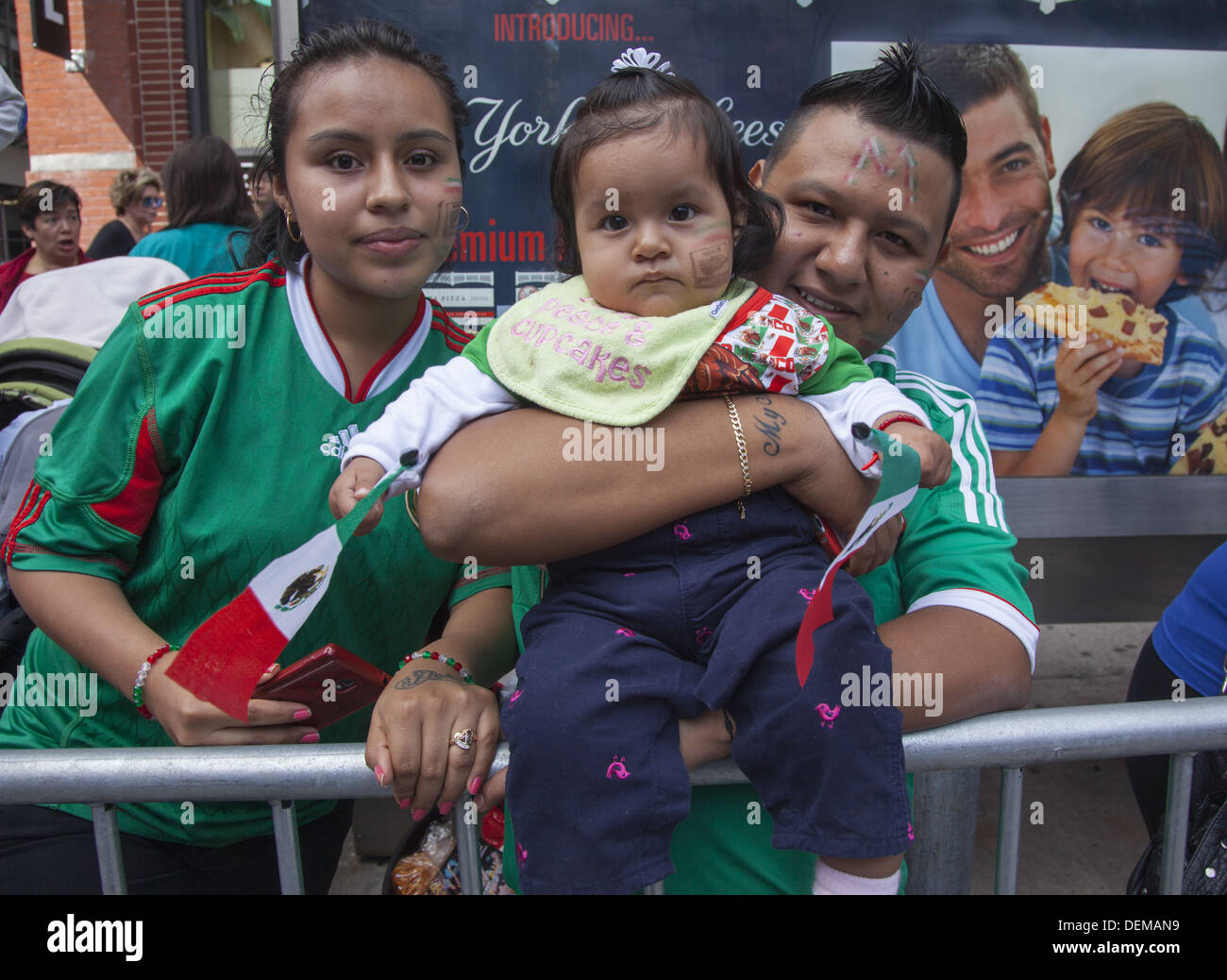 Mexican Independence Day Parade on Madison Avenue, NYC. Mexican spectators watch the parade with pride. - Stock Image
