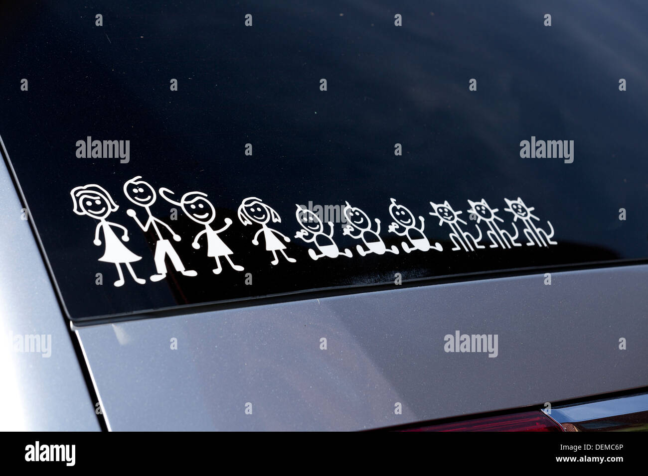 Large family stick figure decal on minivan rear windshield - USA - Stock Image