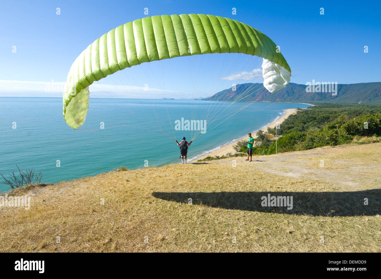 Female Paraglider jumping from Rex Lookout, Northern Queensland, Australia Stock Photo