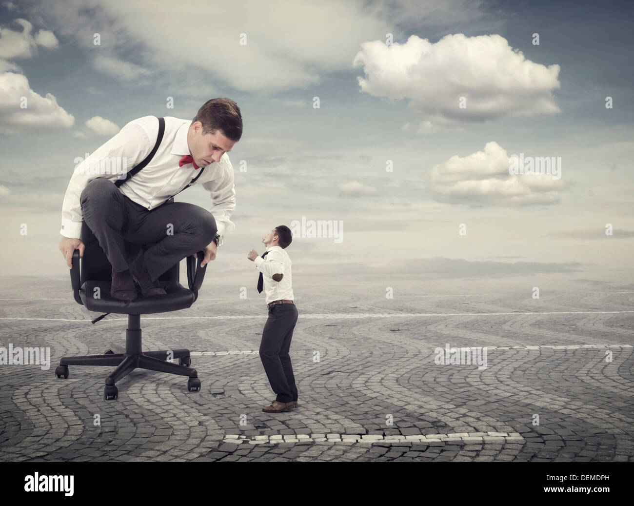 Furious boss yelling at an employee - Stock Image