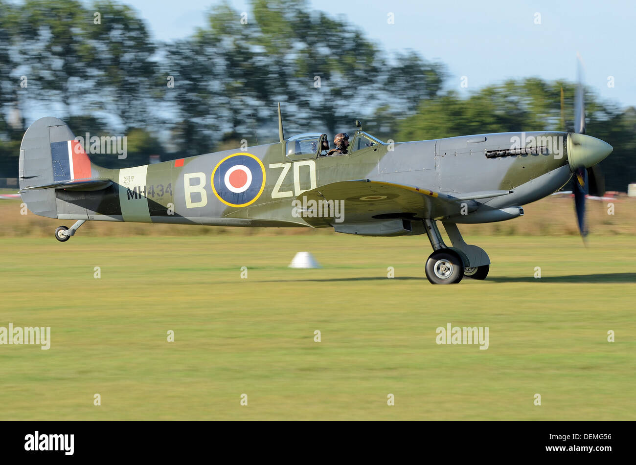 Supermarine Spitfire Mark IX MH434 taking off to display from a grass airfield. MH434 has starred in many films and on tv - Stock Image