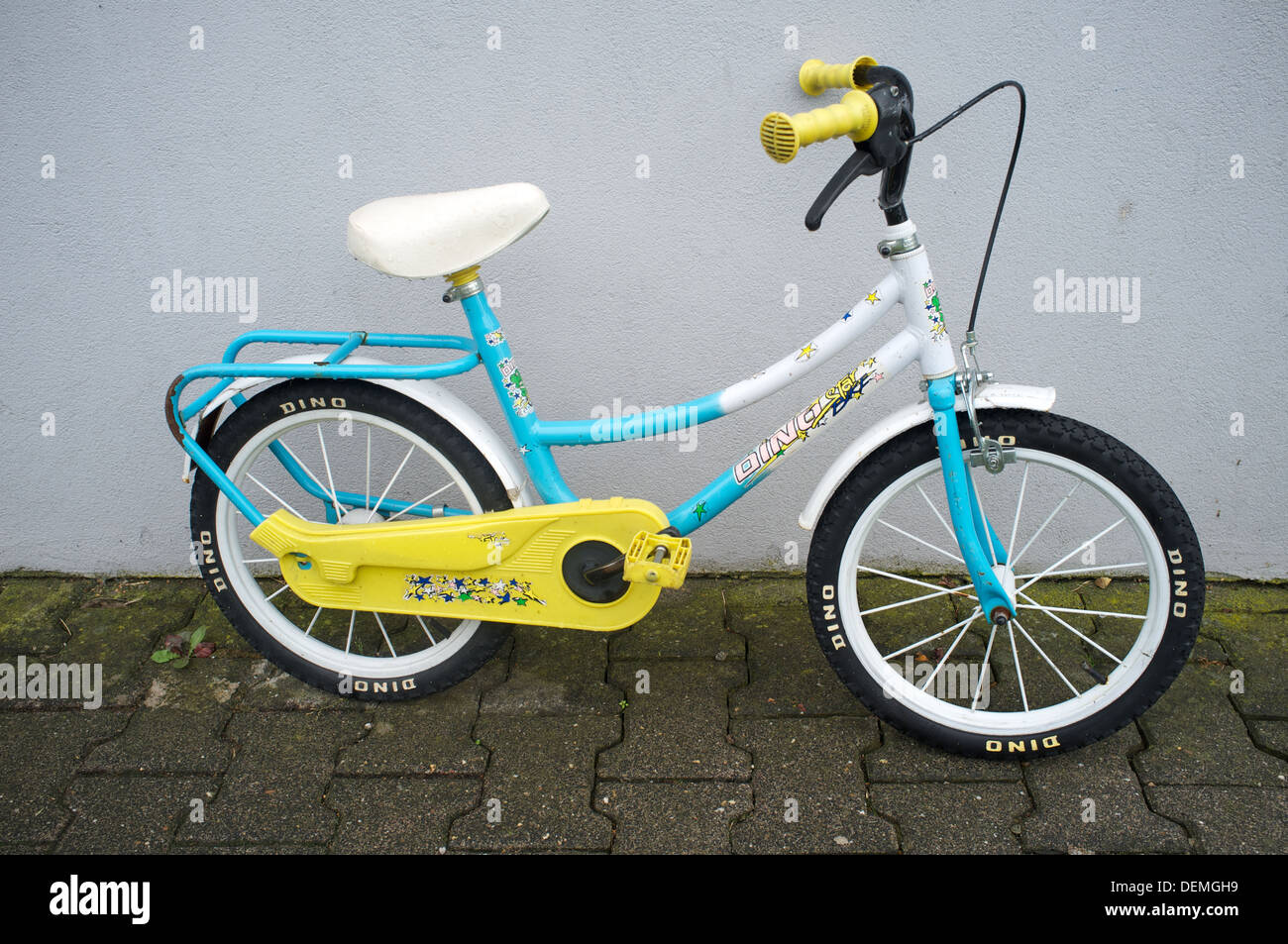 Dino childrens bicycle - Stock Image