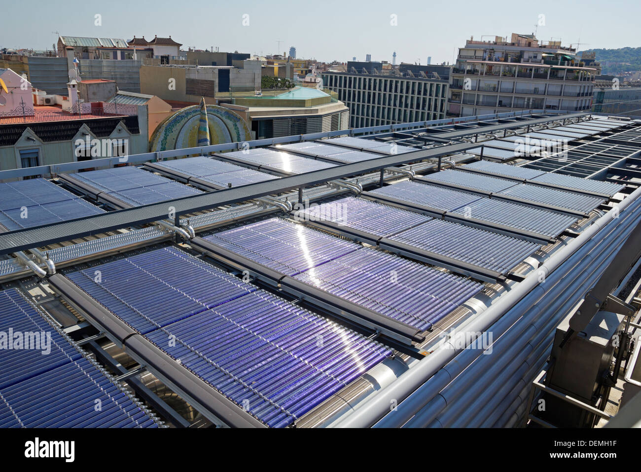 Solar vacuum tube in an urban building, greater energy efficiency. - Stock Image