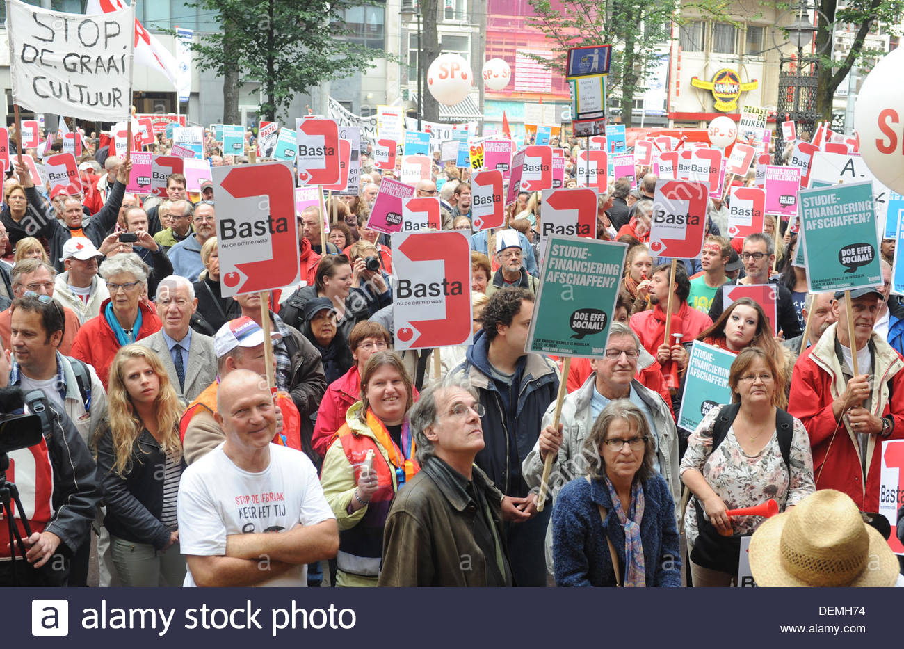 Amsterdam, Netherlands. 21st Sep, 2013. Demonstration against government cuts. Amsterdam NL  In Cities throughout The Netherlands demonstrators take to the streets to protest against proposed governemnt cuts. Demonstrators listen to speeches on Beursplein - Stock Image
