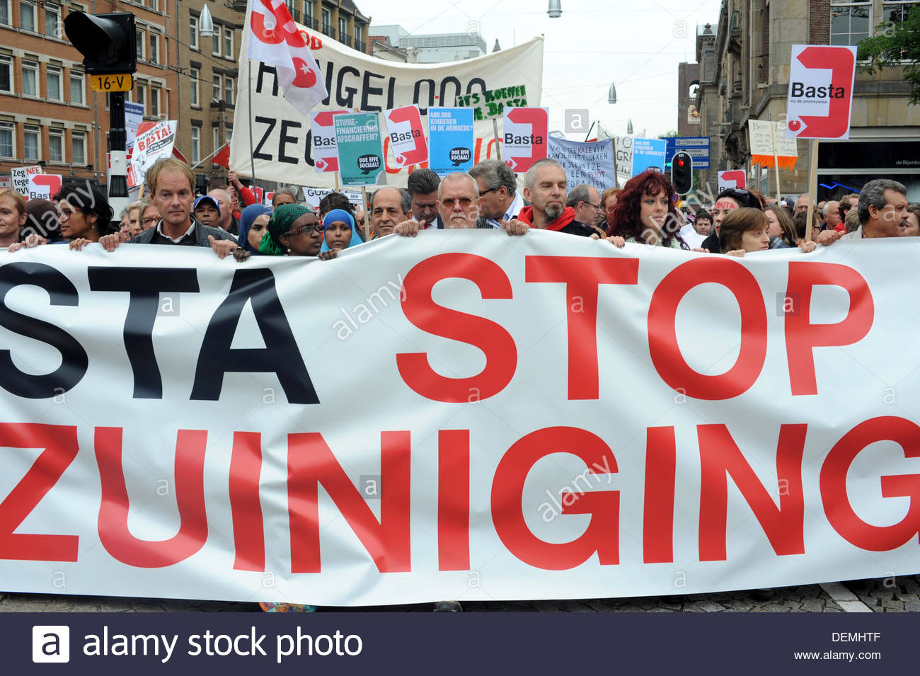 Amsterdam, Netherlands. 21st Sep, 2013. Demonstration against government cuts. Amsterdam NL  In Cities throughout The Netherlands demonstrators take to the streets to protest against proposed governemnt cuts. The march makes its way through Dam Square. - Stock Image
