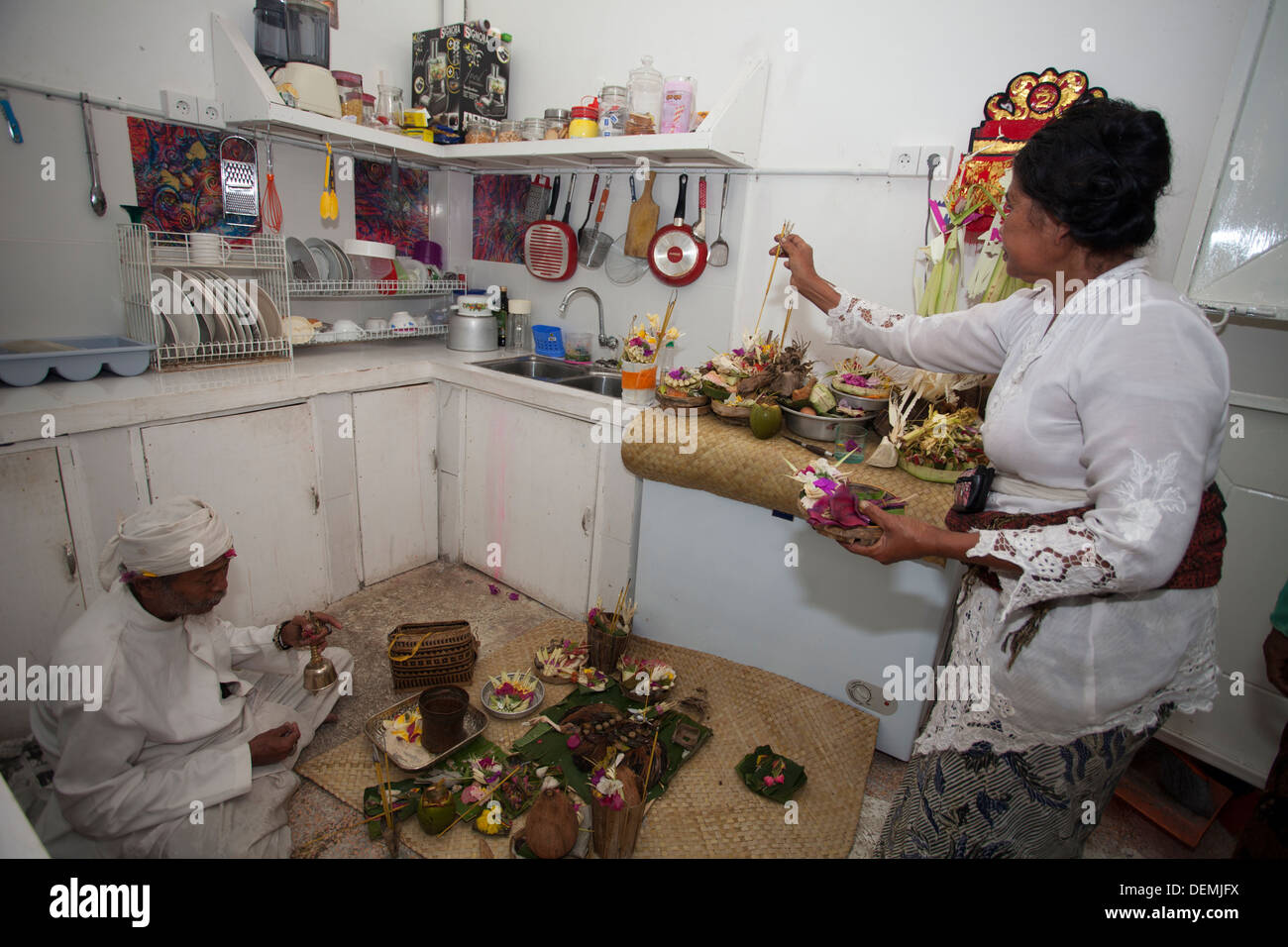 Indonesia Priest blessing new office space kitchen Bali Asia ceremony gods spirits protect protection luck profitable bless art - Stock Image