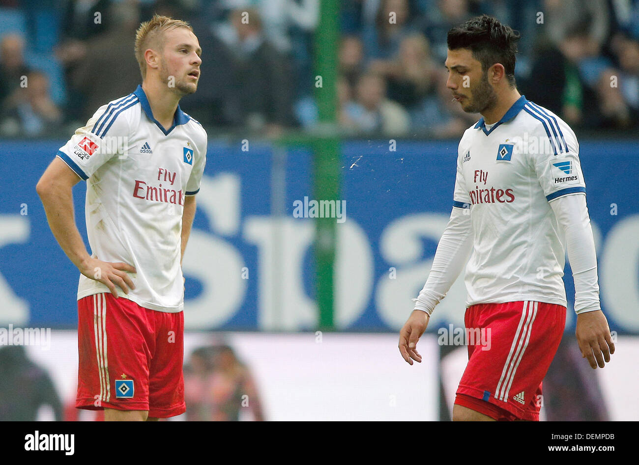 Hamburg, Germany. 21st Sep, 2013. Hamburg's Maximilian Beister (L) and Tolgay Arslan are disappointed after the Bundesliga soccer match between Hamburger SV and Werder Bremen at Imtech-Arena in Hamburg, Germany, 21 September 2013. The match ended 0-2. Photo: AXEL HEIMKEN (ATTENTION: Due to the accreditation guidelines, the DFL only permits the publication and utilisation of up to 15 pictures per match on the internet and in online media during the match.)/dpa/Alamy Live News - Stock Image