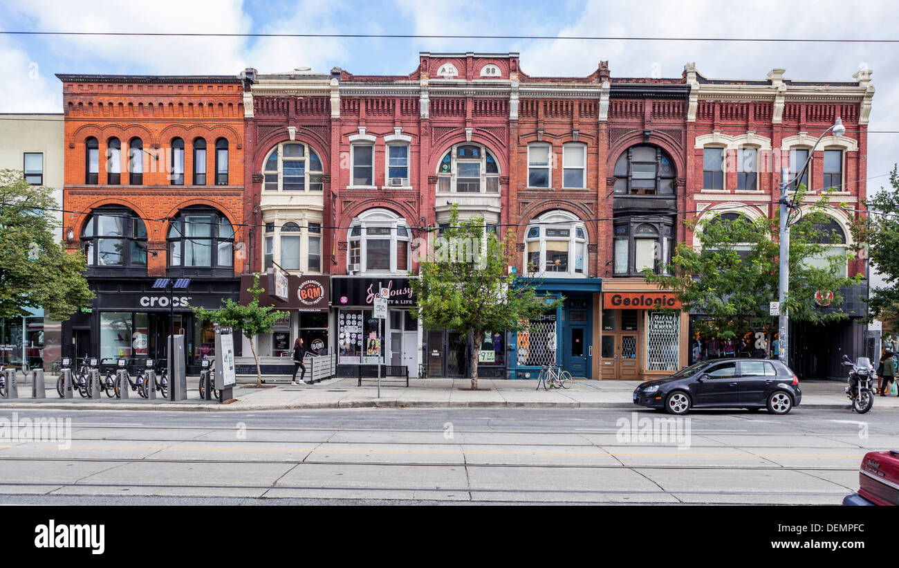 Shops and apartments in attractive old brick buildings in Queen St W, Toronto - Stock Image