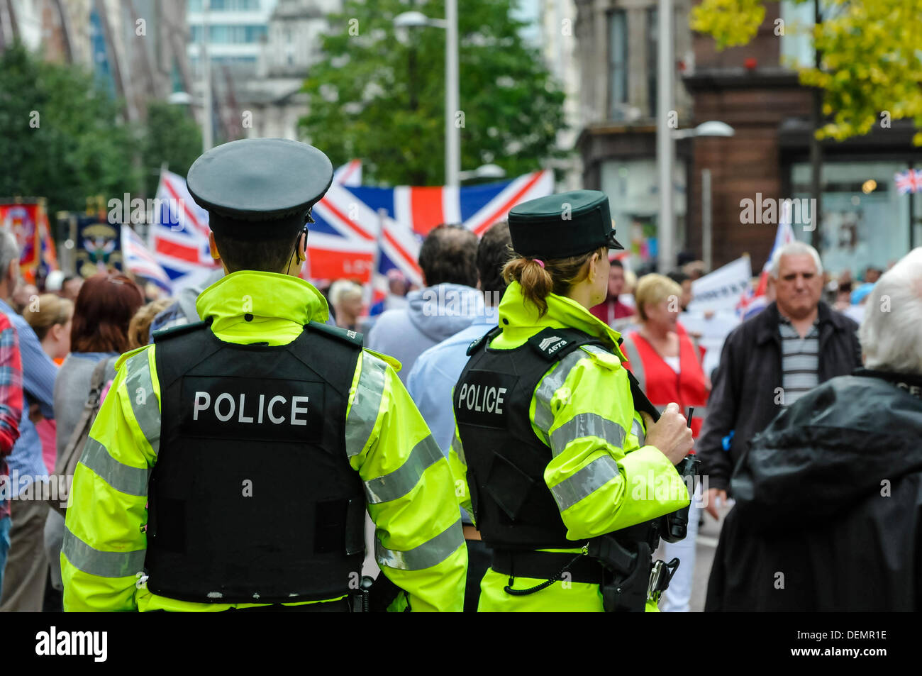 Belfast, Northern Ireland, 21st September 2013 - PSNI officers watch as the parade makes its way from Belfast City Hall to Woodvale Credit:  Stephen Barnes/Alamy Live News - Stock Image