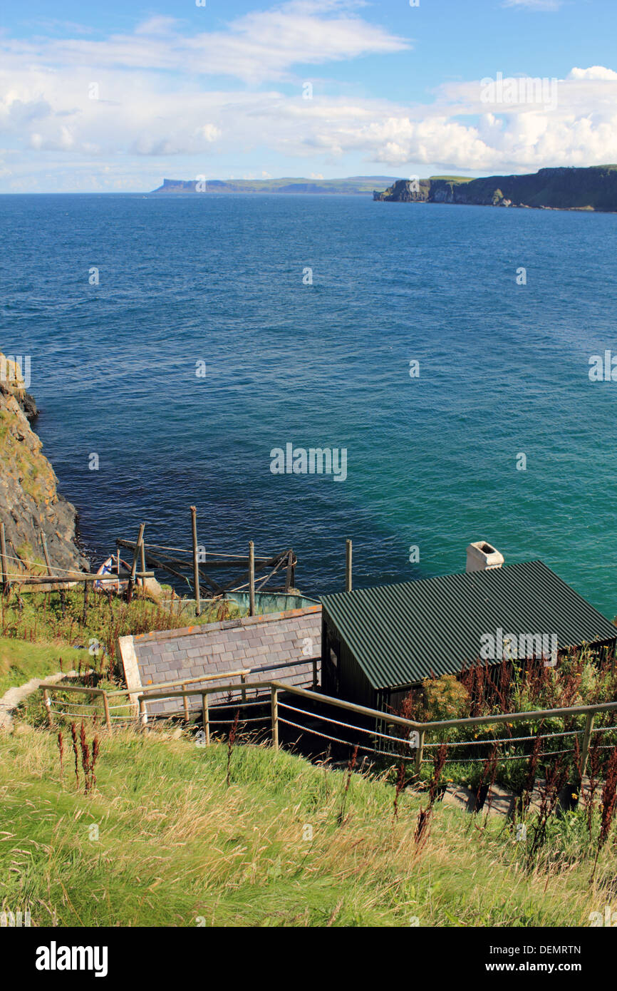 Fishermans hut at Carrick-a-Rede, rope bridge on the Causeway Coastal Route, Northern Ireland. - Stock Image