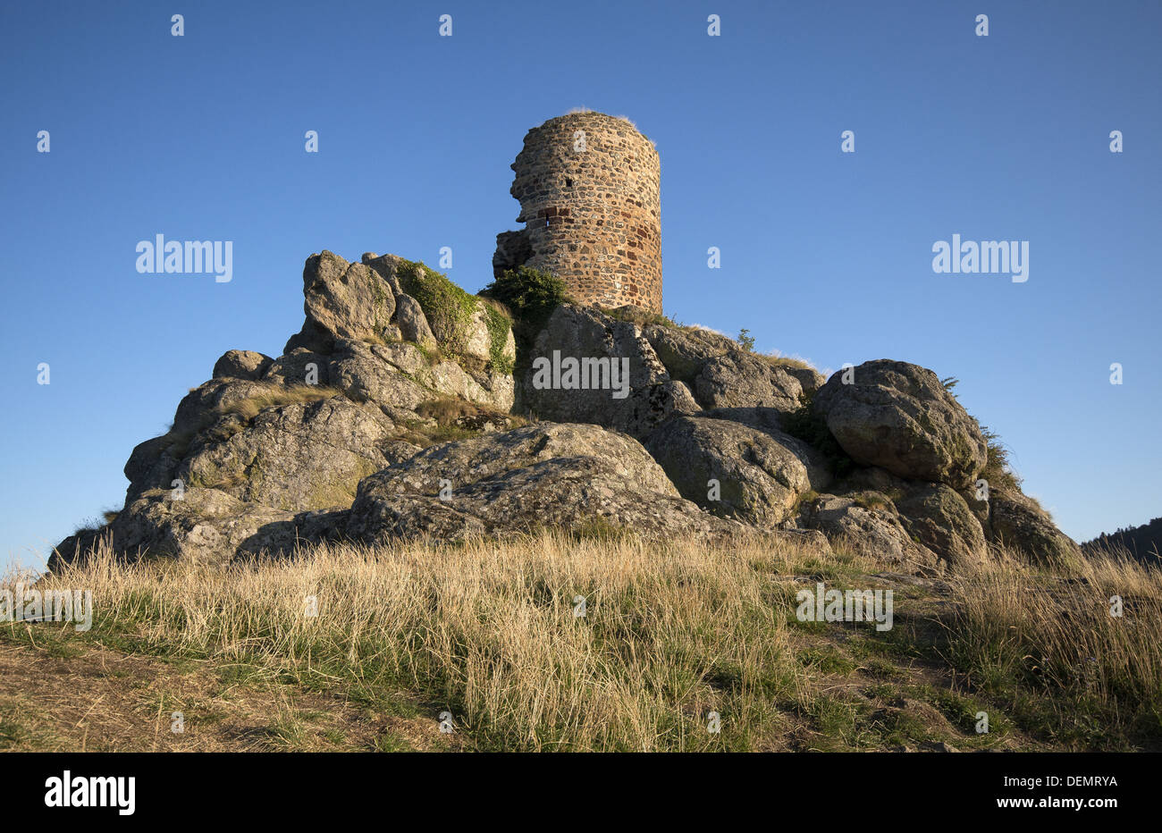 Castle ruins next to the chapel of St James on the GR65 walking route, the Way of St James in Rochegude, France - Stock Image