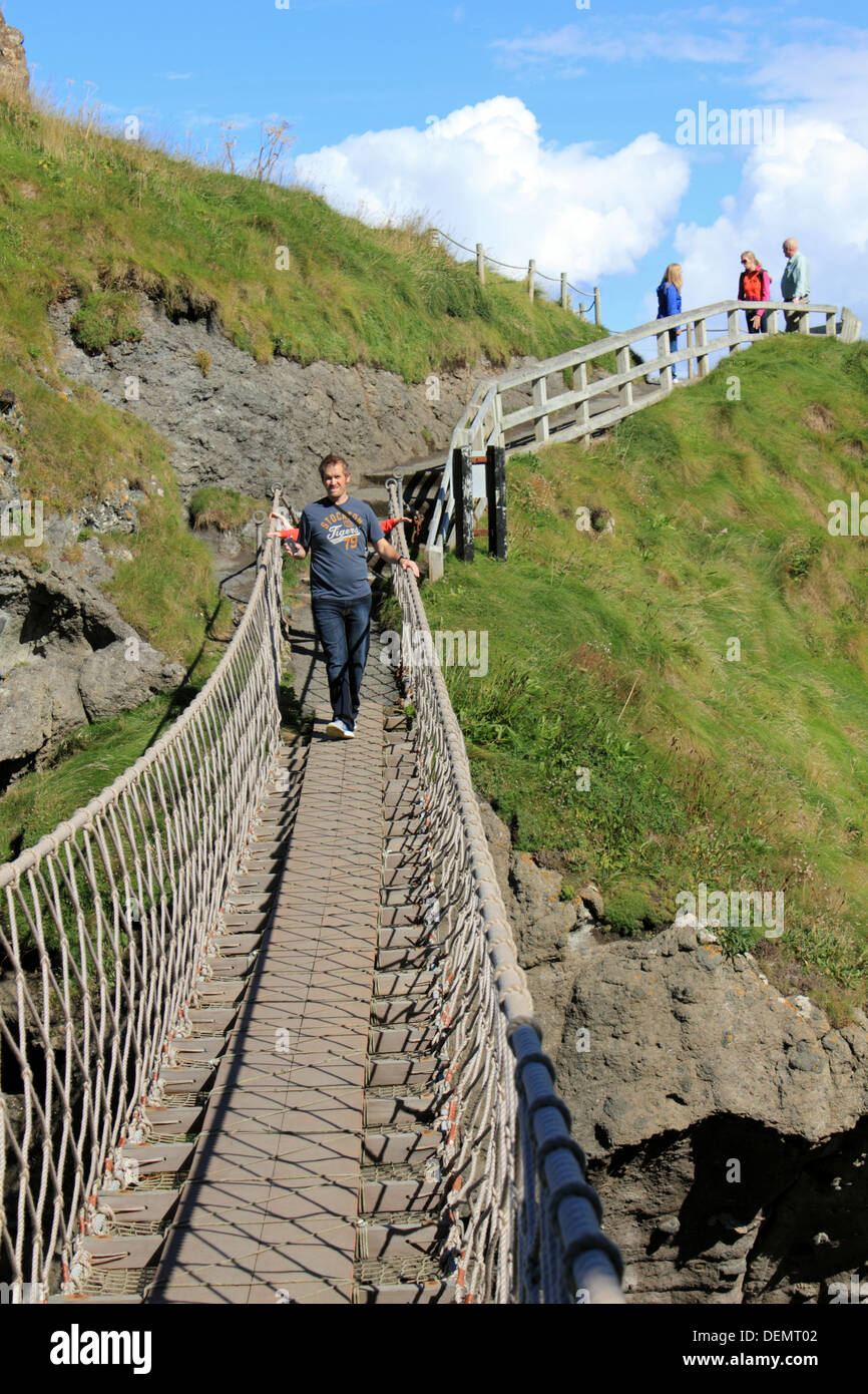 People on Carrick-a-Rede, rope bridge on the Causeway Coastal Route, Northern Ireland. - Stock Image