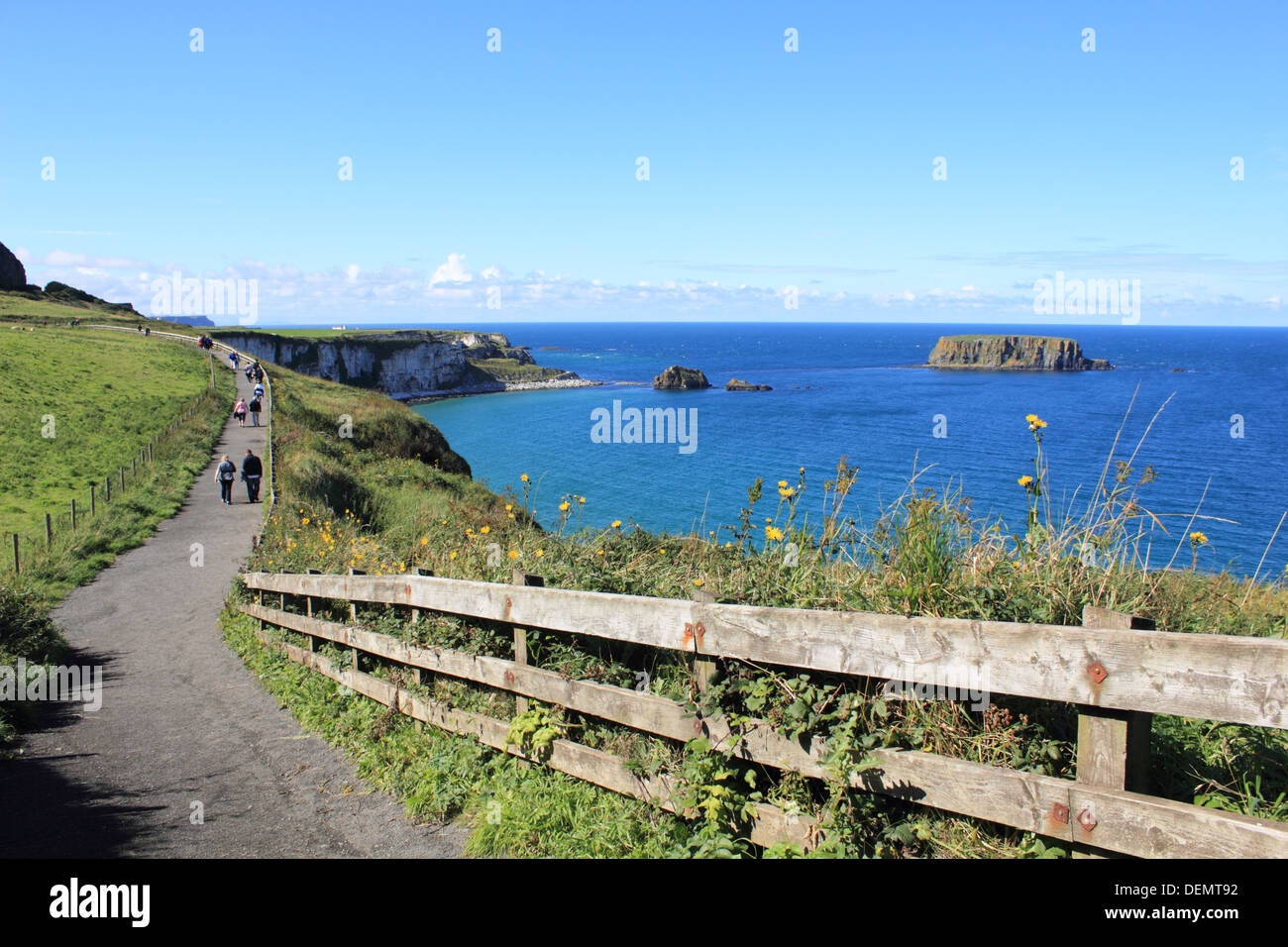 Footpath to Carrick-a-Rede, rope bridge on the Causeway Coastal Route, Northern Ireland. - Stock Image