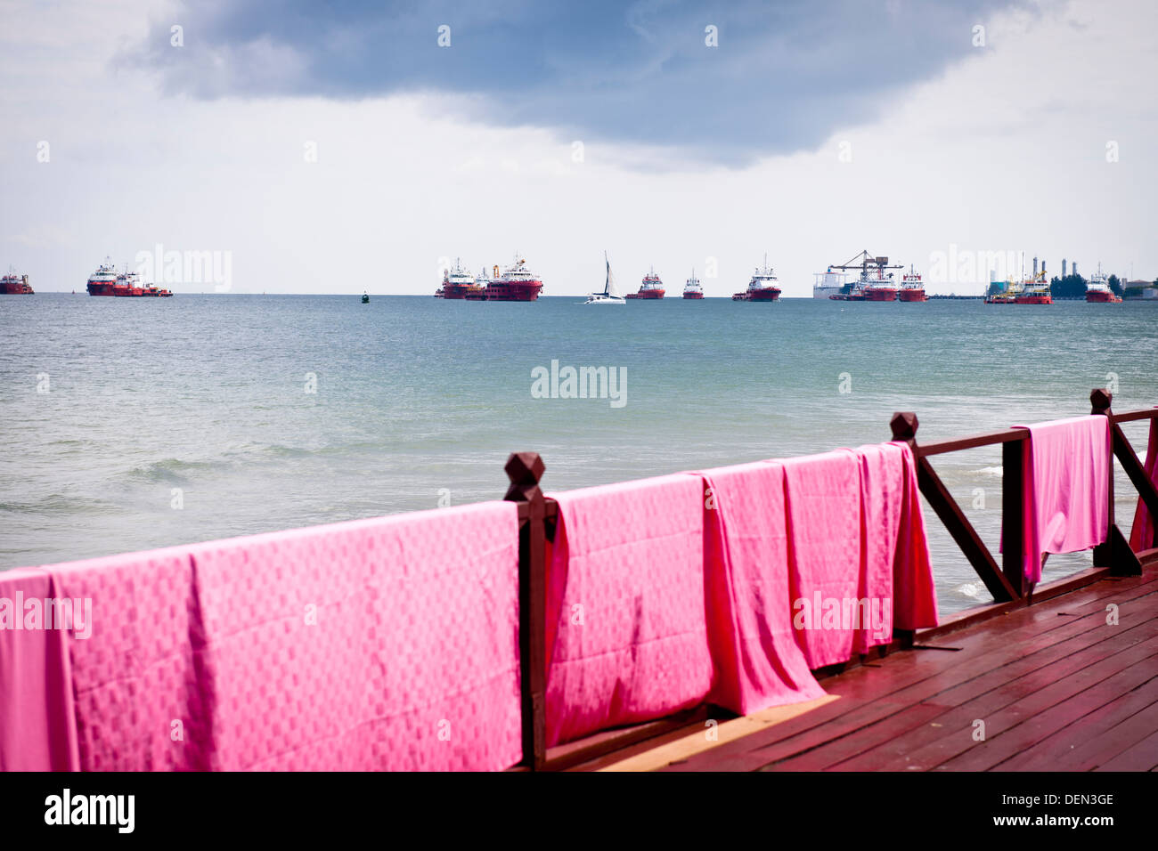 Tablecloths air on the rail of the Yacht Club in Labuan, Malaysia - Stock Image