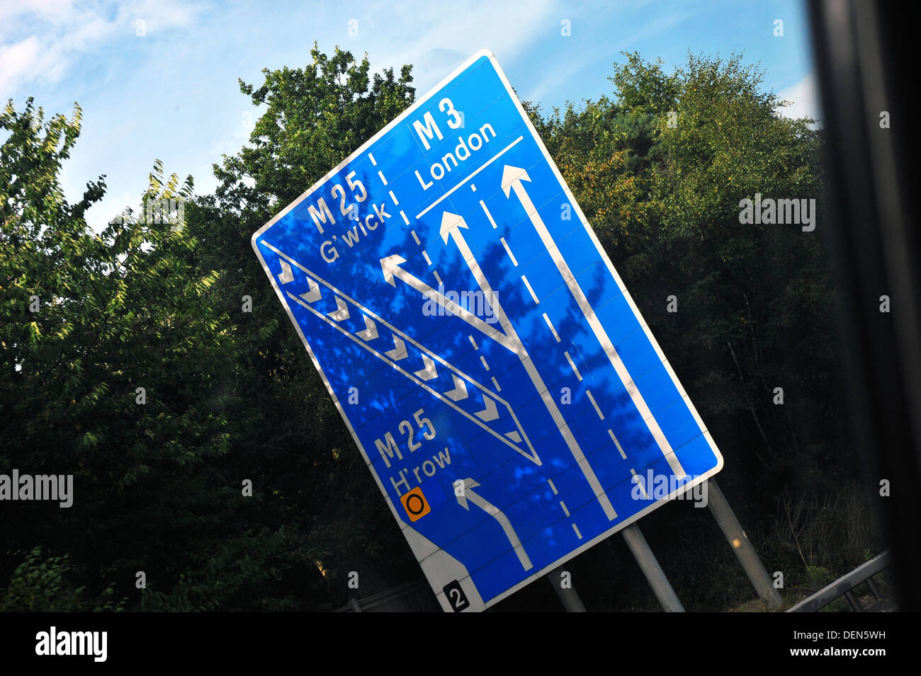 A British road sign directing traffic to Gatwick and Heathrow airports as well as London. - Stock Image