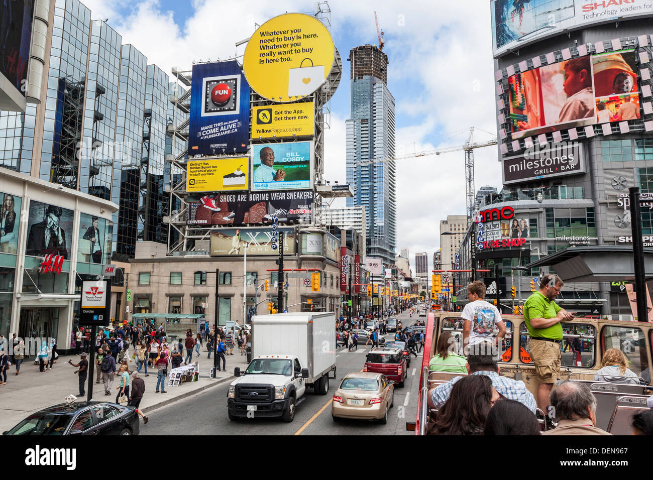 Colourful advertisements and billboards around Dundas Square (also known as YD Square and 'Toronto's Times Square') Toronto - Stock Image