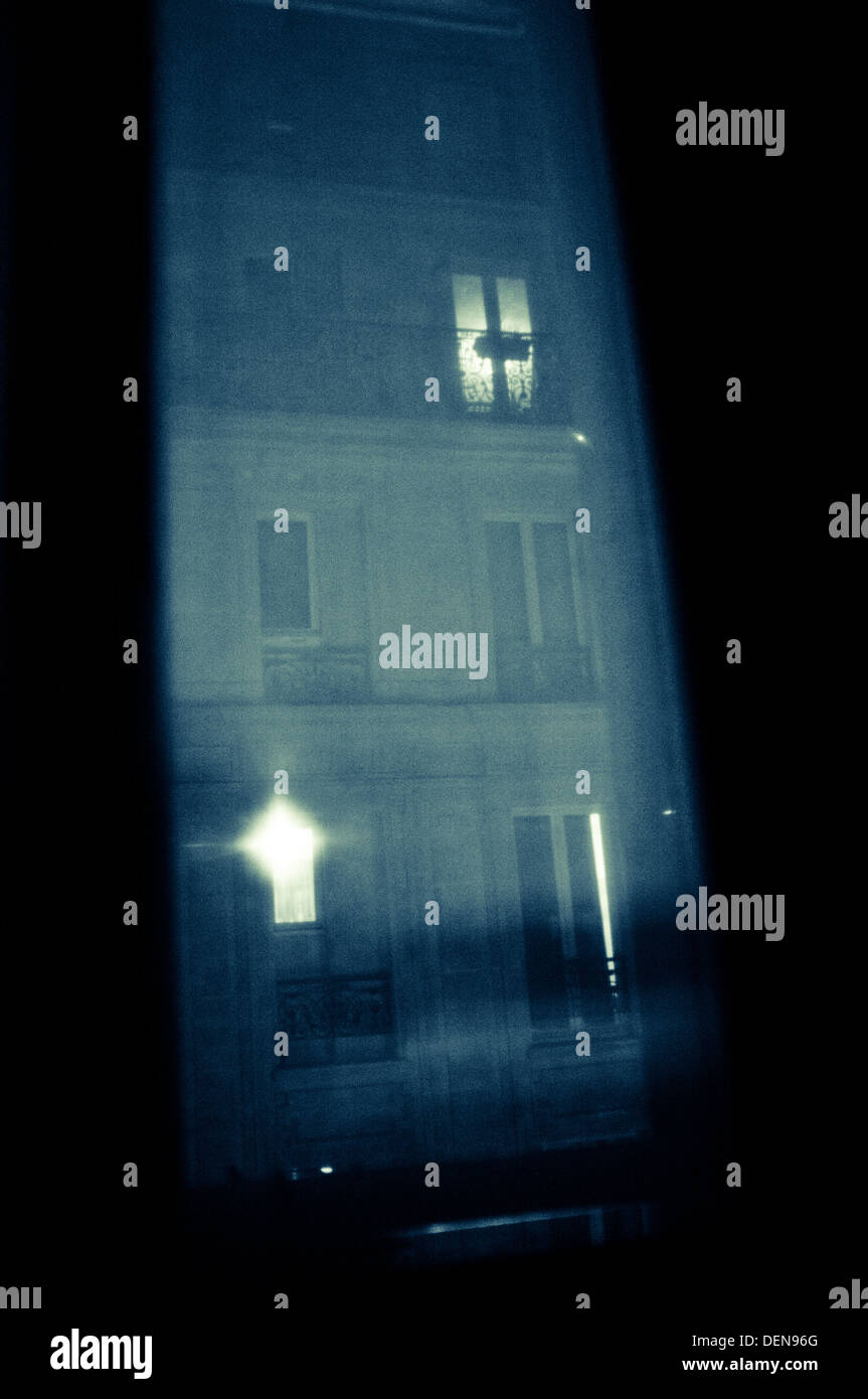 Sinister scene looking out of a hotel window in Paris. - Stock Image