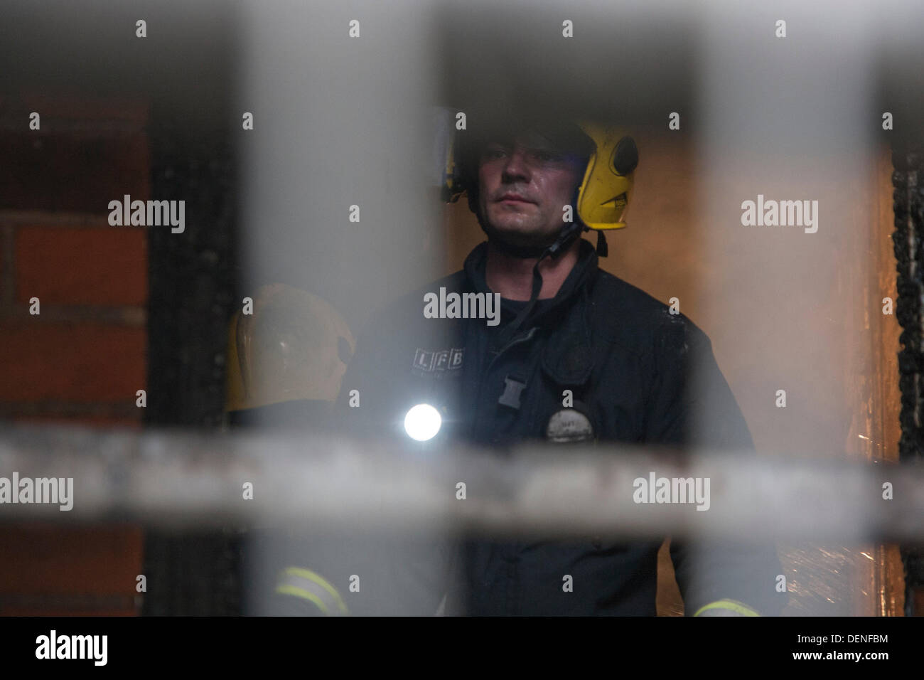 London, UK. 22nd Sep, 2013.  A firefighter examines the damage after a fire in a ground floor flat,  in Albert Mansions, Kensington, across the road from The Royal Albert Hall. Credit:  Paul Davey/Alamy Live News - Stock Image