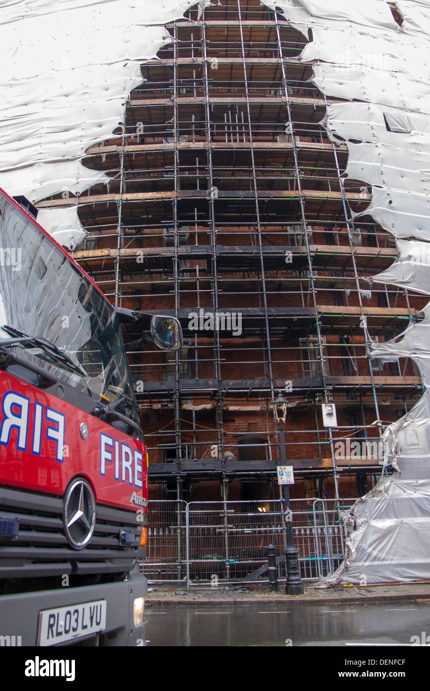 London, UK. 22nd Sep, 2013.  Damage to scaffolding after a fire in a ground floor flat,  in Albert Mansions, Kensington, across the road from The Royal Albert Hall. Credit:  Paul Davey/Alamy Live News - Stock Image