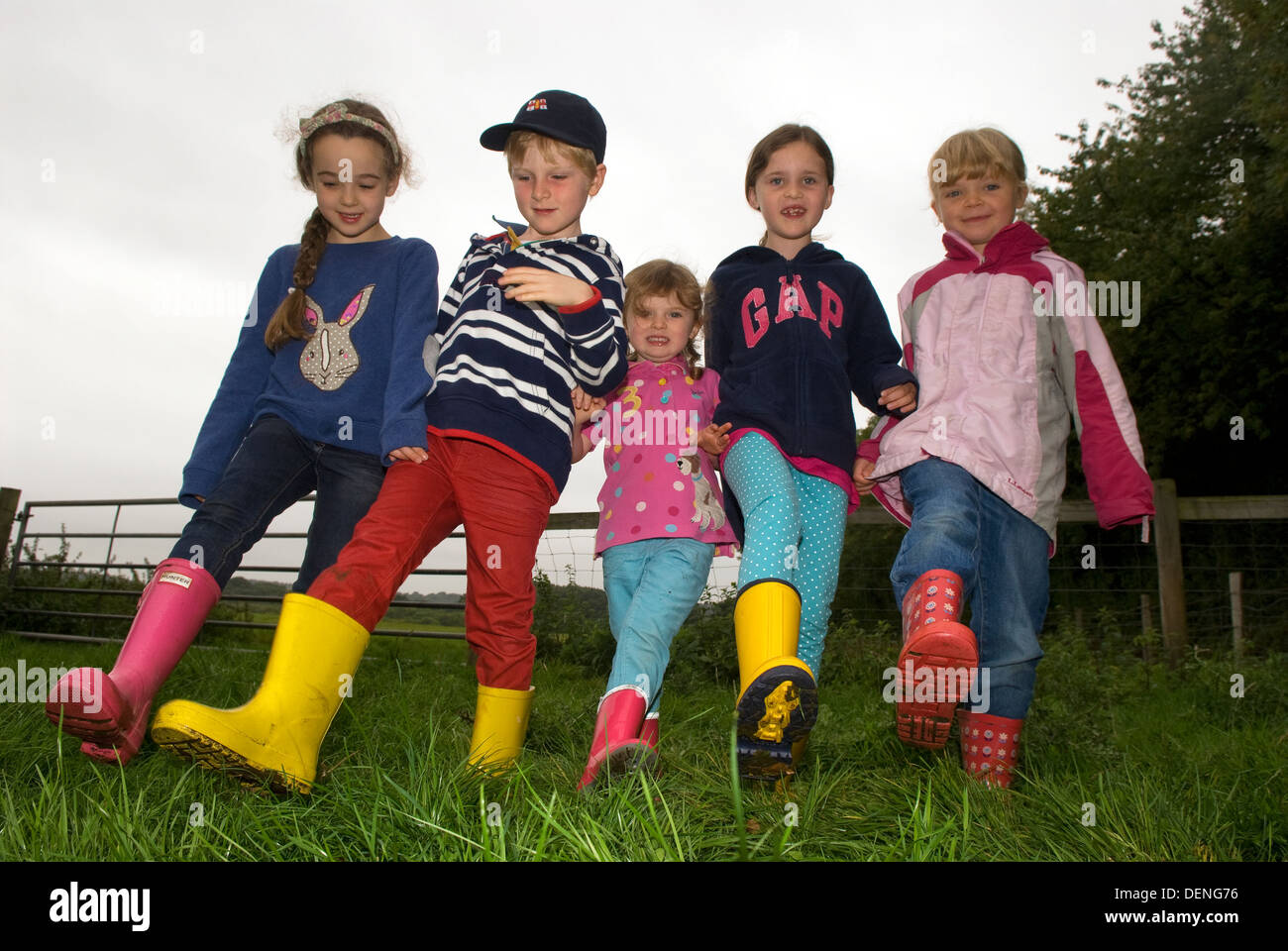 Group of youngsters larking around whilst on a countryside farm tour and walk, near Haslemere, Surrey, UK. - Stock Image
