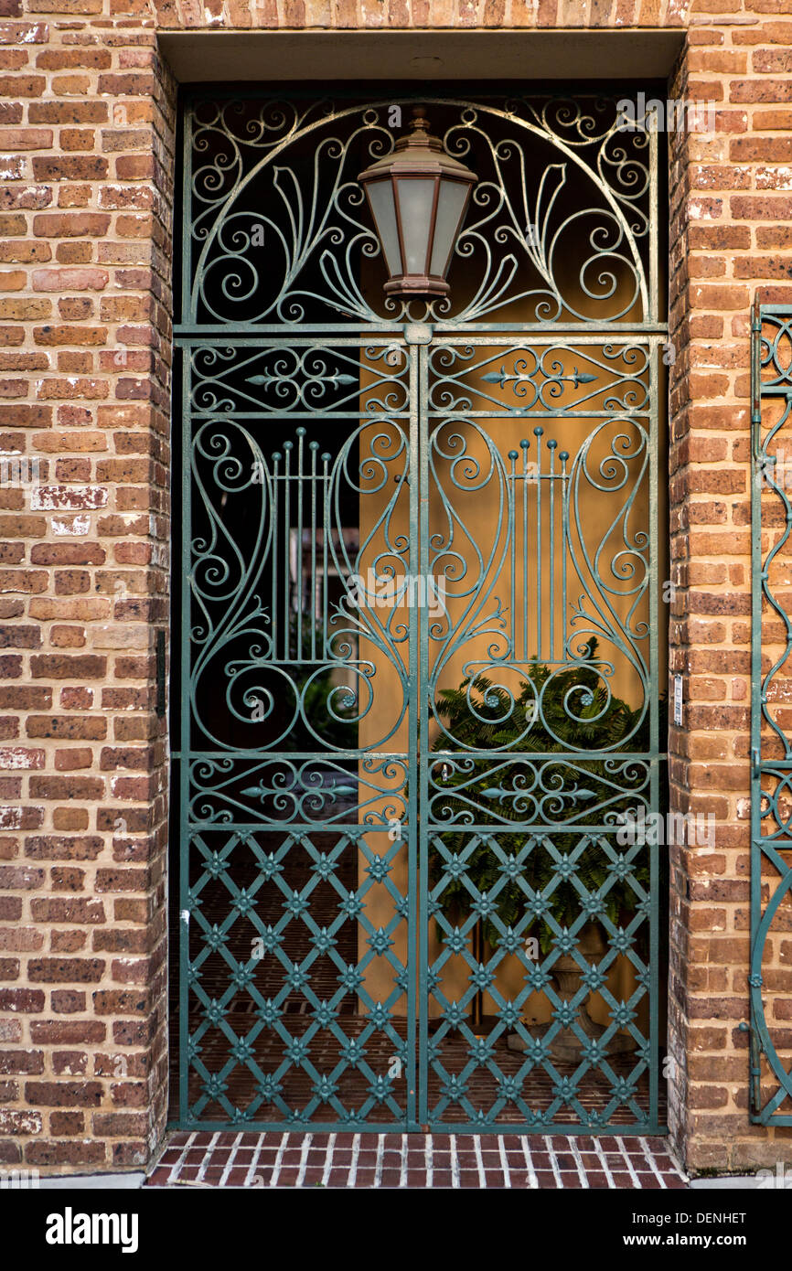 Decorative iron gate on the Old Dock Street Theatre in Charleston, SC. - Stock Image