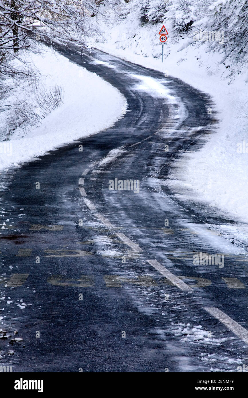 snow covered and icy road. - Stock Image