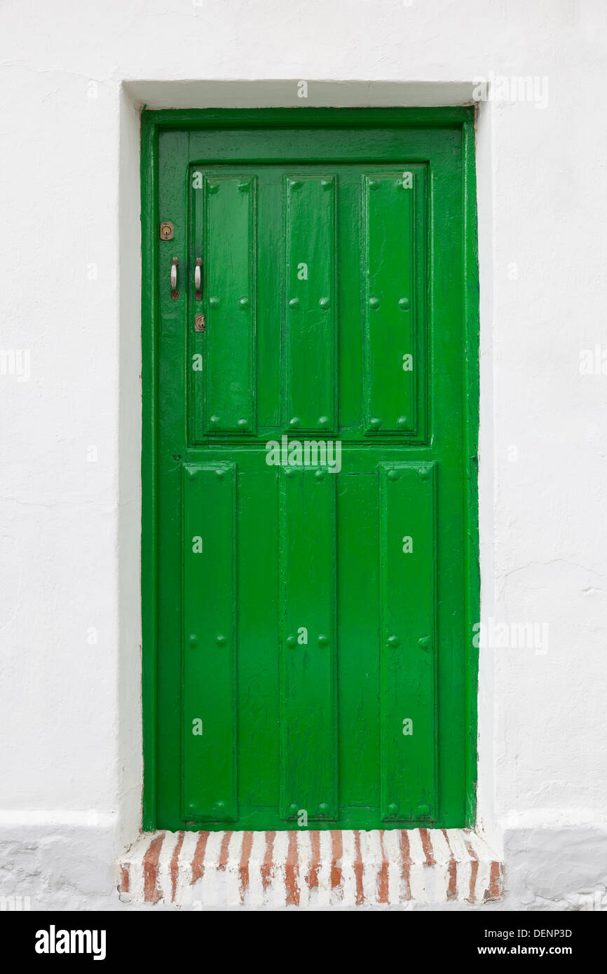 Typical green door in the village of Baltanás - Province of Palencia, Castile and León, Spain - Stock Image