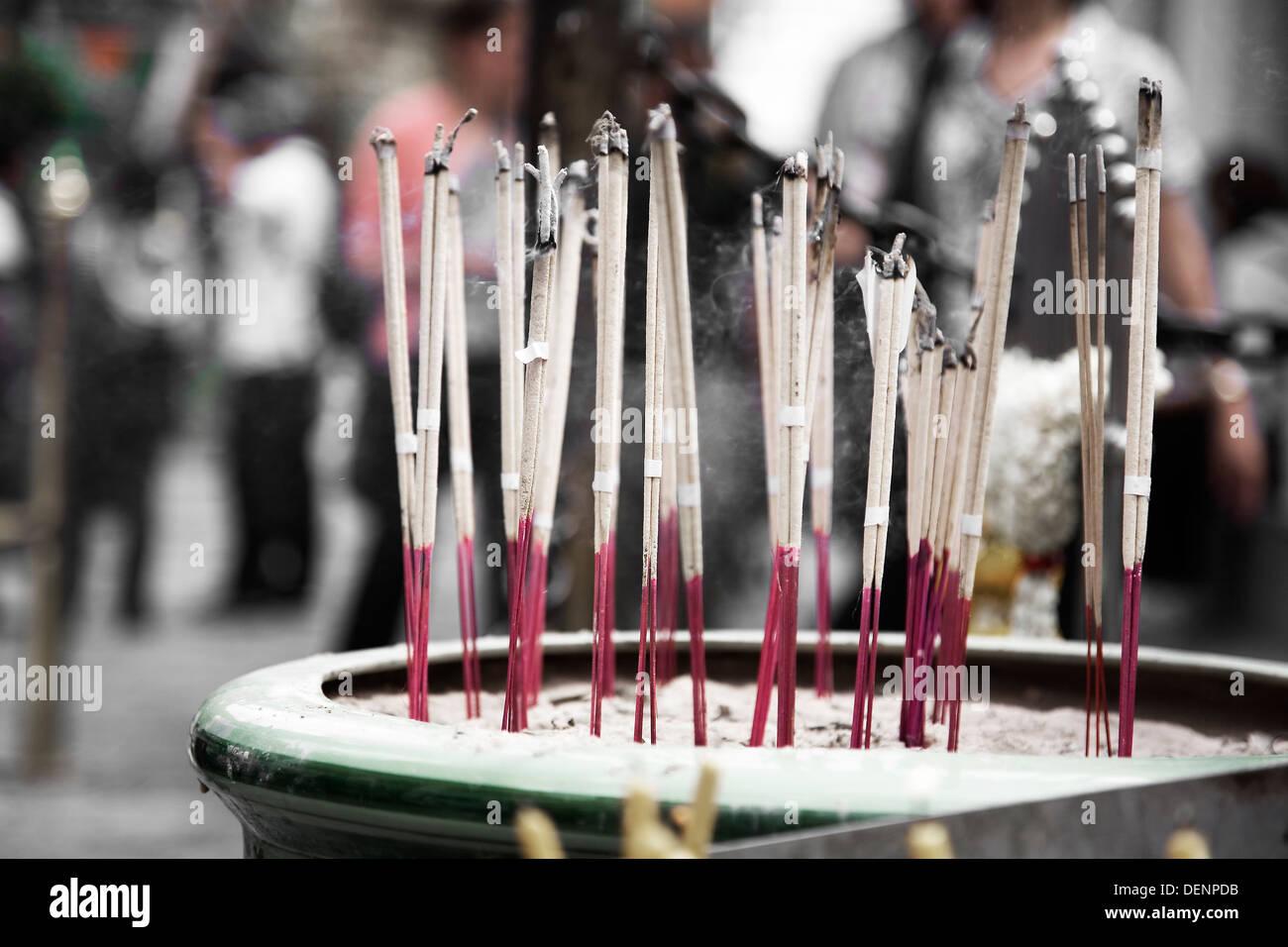 Incense sticks. Wat Phra Kaew, or Temple of the Emerald Buddha. Grand Palace. Bangkok, Thailand, Asia. - Stock Image
