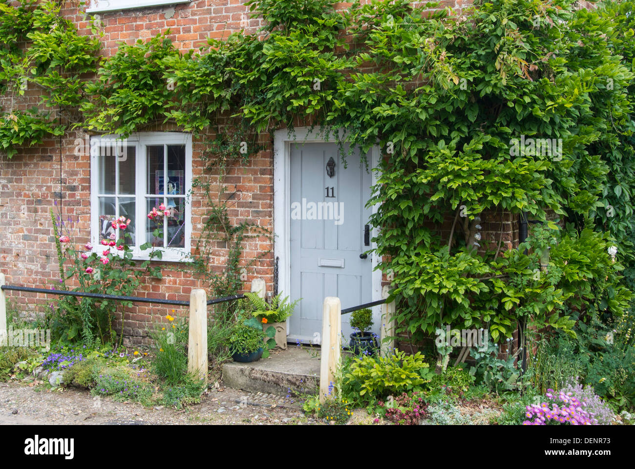 Red brick country cottage door, - Stock Image