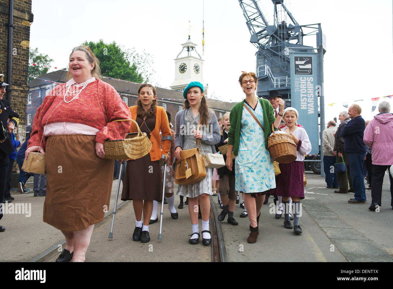Chatham, UK. 21st Sep, 2013. Salute to the 40's - Britain's 1940's Home Front Event at The Historic Dockyard Chatham. Children dressed in 1940's clothes being evacuated to the country. Credit:  Tony Farrugia/Alamy Live News - Stock Image