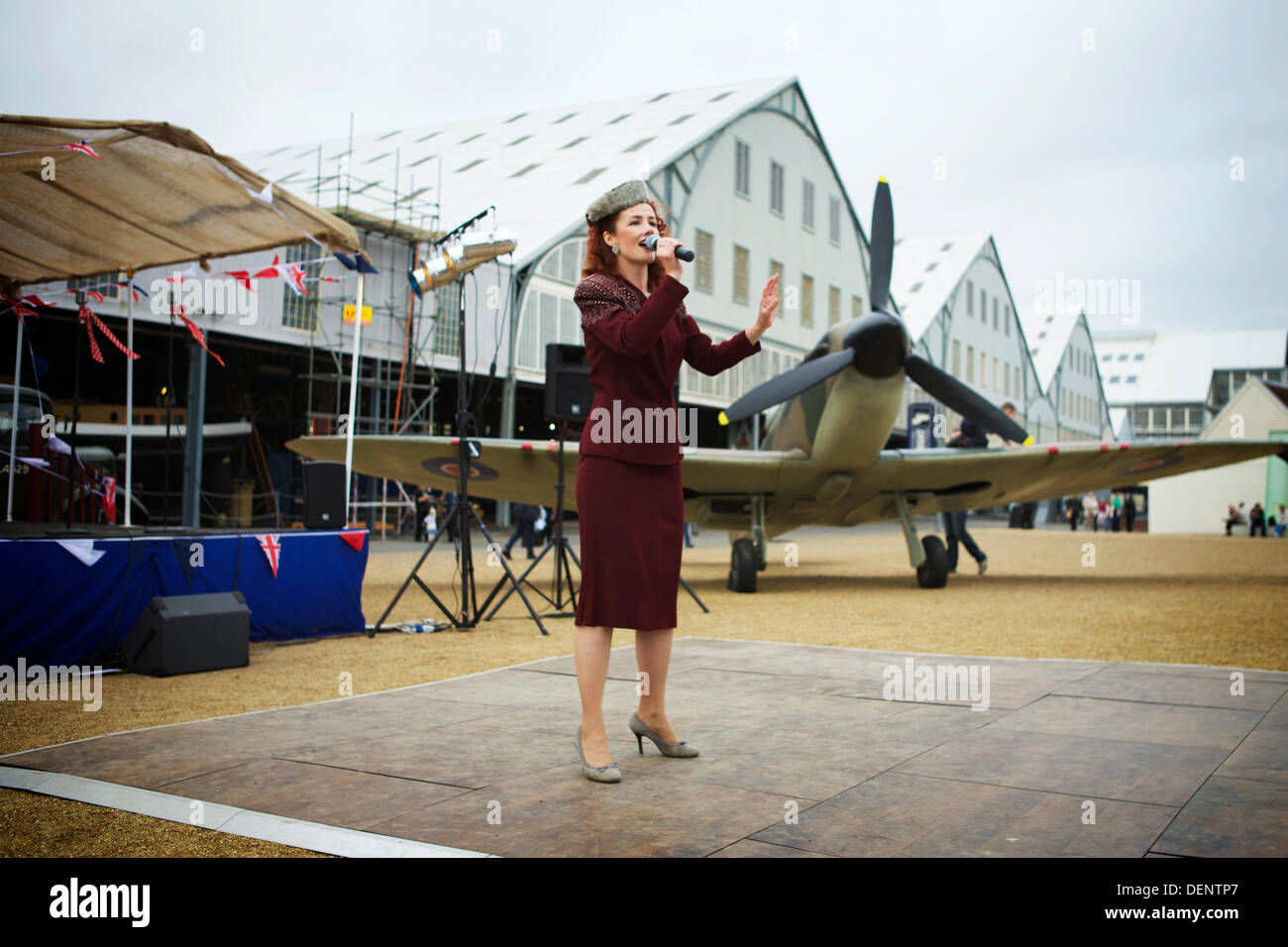Chatham, UK. 21st Sep, 2013. Salute to the 40's - Britain's 1940's Home Front Event at The Historic Dockyard Chatham. Spitfire / female singer - Stock Image