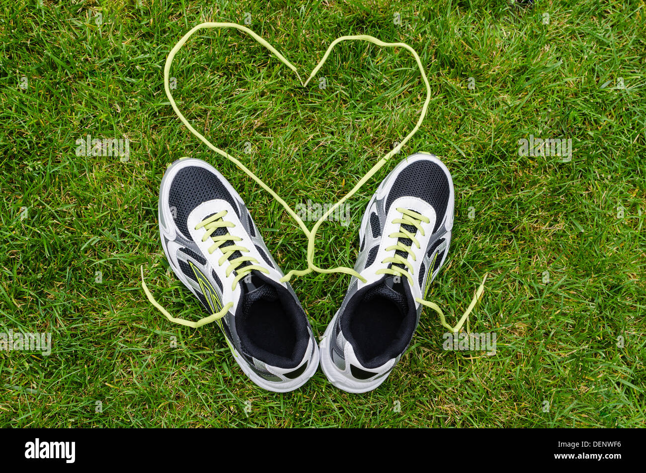brand new 5c995 ee0bf White sneakers for running on grass with heart - Stock Image