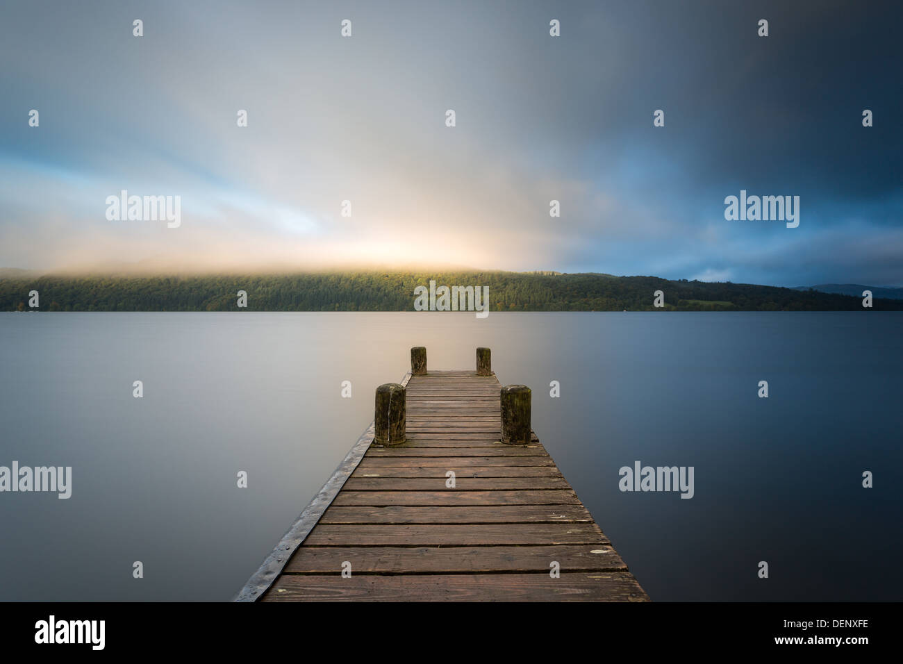 Misty sunlit pier, Lake Windermere in the English Lake District (UK) - Stock Image