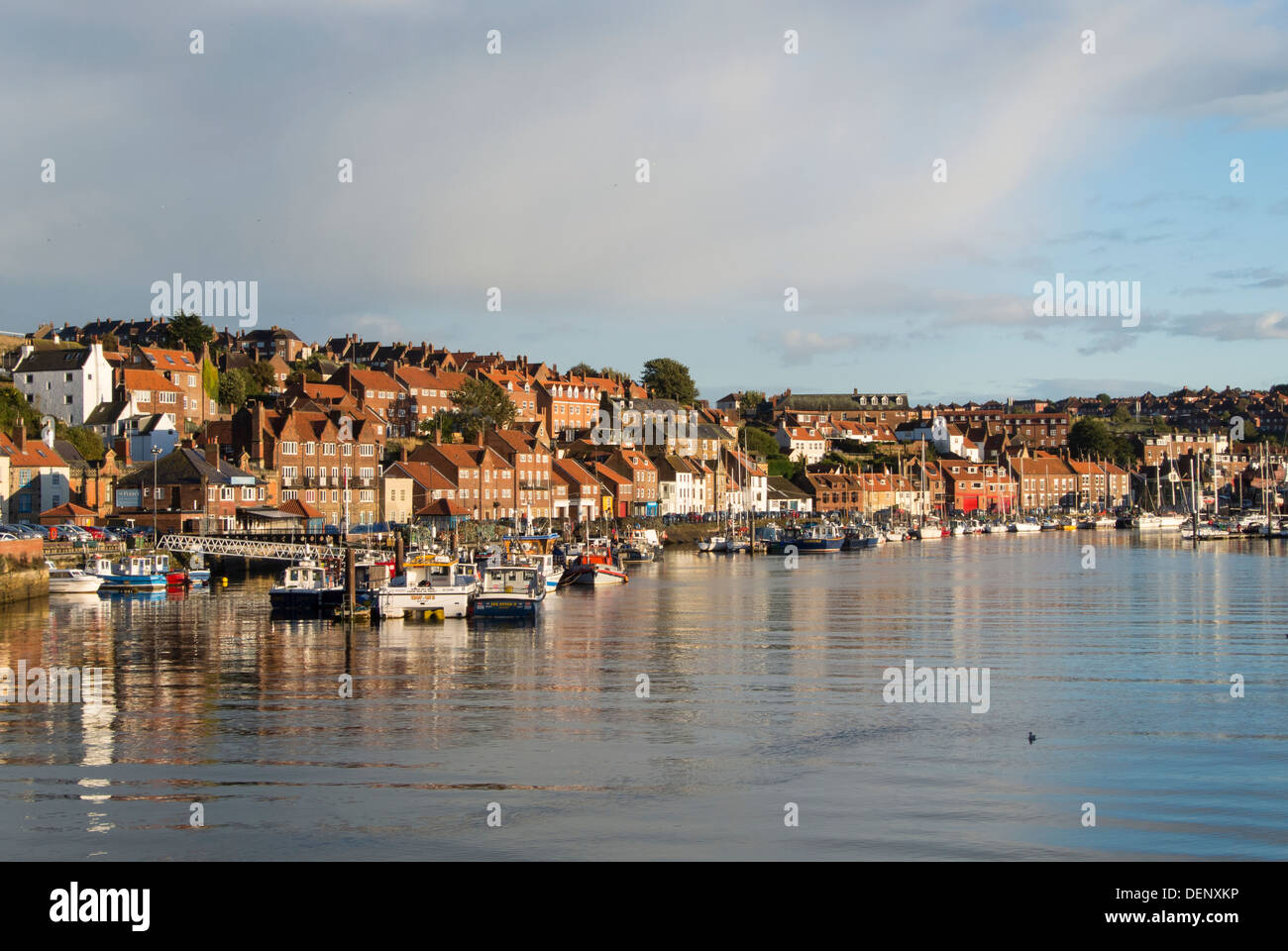 View of Whitby Harbour, the mouth of the River Esk. - Stock Image