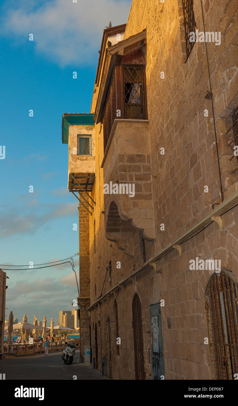 Old houses in an ally at Old Jaffa in the old port / marina area Tel Aviv is seen foreground Stock Photo