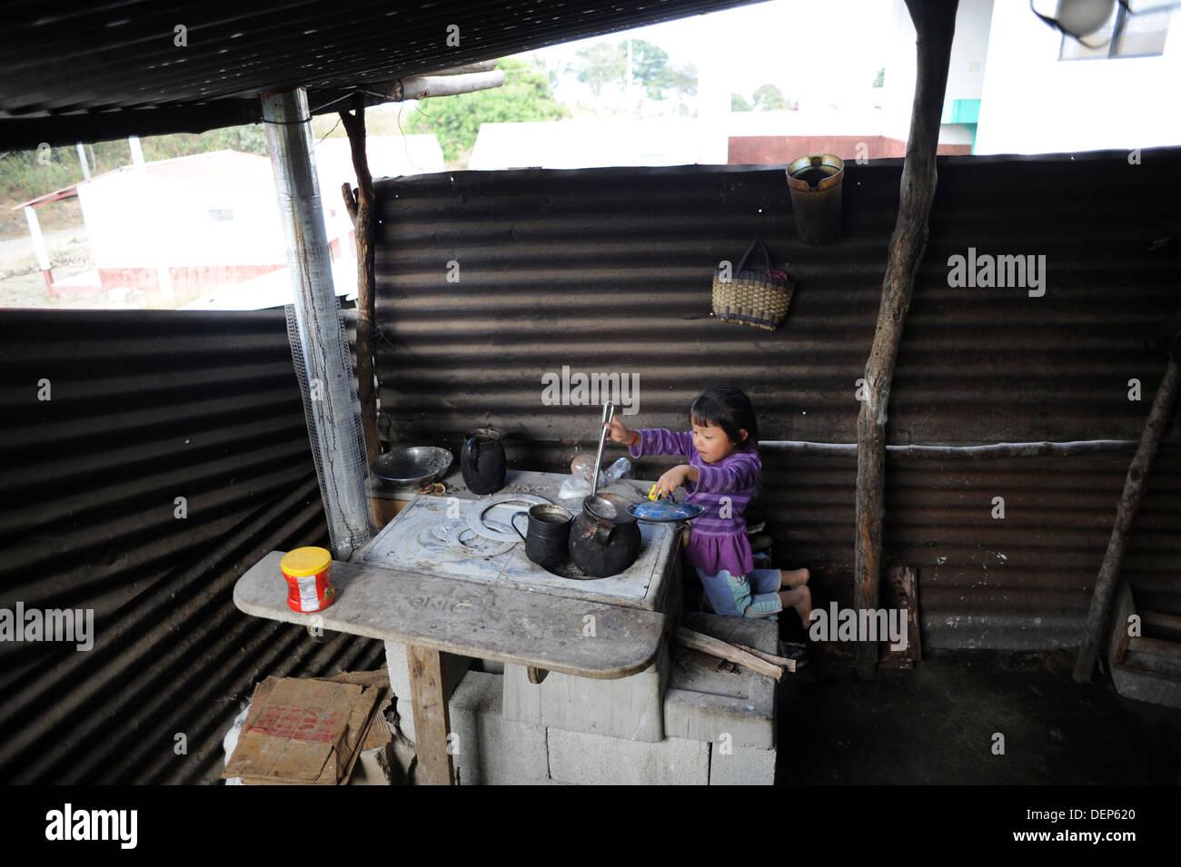 A mayan guatemala indigenous girl cooks in the kitchen in Chuk Muk, Santiago Atitaln, Guatemala. - Stock Image